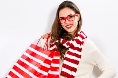 Happy young woman holding shopping bags. On a white background Royalty Free Stock Images