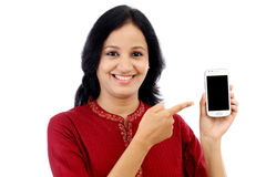 Happy young woman holding smart phone Royalty Free Stock Images