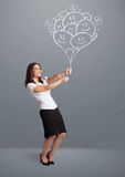 Happy woman holding smiling balloons drawing Royalty Free Stock Images