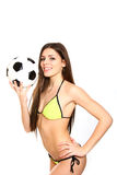 Happy young woman holding a soccer ball on a white background Stock Photos