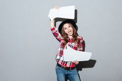 Happy young woman holding speech bubble Royalty Free Stock Photos