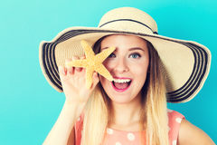 Happy young woman holding a starfish Stock Photo