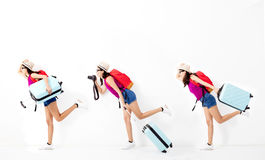 Happy young woman holding suitcase  and running Royalty Free Stock Photo