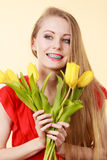 Happy young woman holding tulip bouquet Stock Photo