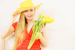 Happy young woman holding tulip bouquet Royalty Free Stock Image