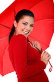 Happy Young Woman Holding Umbrella. Attractive young woman posing with umbrella on white background stock photography