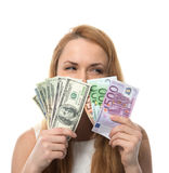 Happy young woman holding up cash money compare euro dollars Royalty Free Stock Image