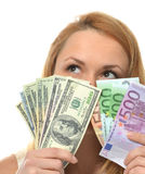 Happy young woman holding up cash money dollars and euros Stock Photos