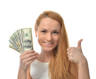 Happy young woman holding up cash money dollars Stock Image