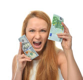 Happy young woman holding up cash money one hundred euro and dol Stock Images
