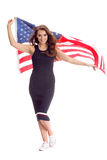 Happy young woman holding USA flag. Image isolated Stock Photos