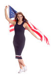 Happy young woman holding USA flag. Image isolated Stock Images