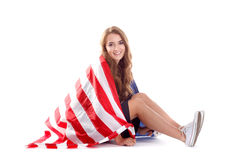 Happy young woman holding USA flag. Image isolated Royalty Free Stock Image