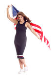 Happy young woman holding USA flag. Image isolated Royalty Free Stock Photos