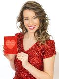 Happy Young Woman Holding a Valentines Card Stock Photography