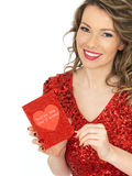 Happy Young Woman Holding a Valentines Card Stock Photo