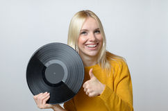 Happy Young Woman Holding Vinyl Record Stock Photo