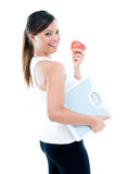 Happy Young Woman Holding Weighing Scale And Apple Stock Photos