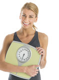 Happy Young Woman Holding Weight Scale Stock Photography