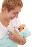 Happy young woman holds on hands her newborn baby Stock Photo