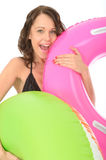 Happy Young woman On Holiday Holding Inflated Rubber Rings Royalty Free Stock Photo