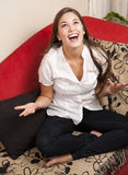 Happy young woman at home Stock Photo