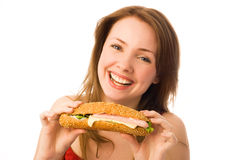 Happy young woman with a hot-dog Stock Images