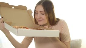 Happy young woman with hot pizza stock images