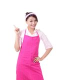 Happy young woman housewife showing Stock Images