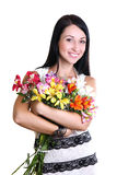 Happy Young Woman Hugging Flowers Stock Photos