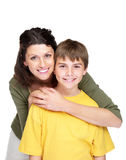Happy young woman hugging her son Stock Images