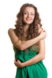 Happy young woman hugging herself Royalty Free Stock Photo