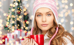 Happy Young Woman In Winter Hat With Cup Stock Photos