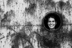 Happy young woman in the industrial zone. Stalkers, abandoned objects. Portrait of happy young woman in the industrial zone. Stalkers, abandoned objects Stock Image