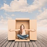 Happy young woman inside a Box. On a pier royalty free stock photos
