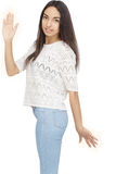 Happy Young Woman Isolated On White Background. Happy Young Woman gesturing high five Isolated On White Background Stock Image