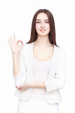 Happy young woman isolated on white background. Happy young woman gesturing ok isolated on white background Royalty Free Stock Photo