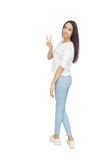 Happy Young Woman Isolated On White Background. Happy Young Woman gesturing victory Isolated On White Background Royalty Free Stock Photos