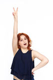 Happy Young Woman Isolated On White Background. Happy Woman gesturing victory Isolated On White Background Stock Image