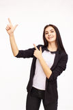 Happy Young Woman Isolated On White Background. Happy Young Woman pointing up Isolated On White Background Royalty Free Stock Photography