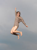 Happy, young woman jumping Stock Photos
