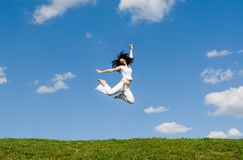 Happy young woman is jumping Royalty Free Stock Photography