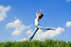 Happy young woman jumping Royalty Free Stock Photos
