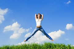 Happy young woman jumping Royalty Free Stock Image