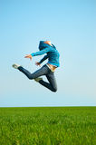 Happy young woman jumping Stock Photo
