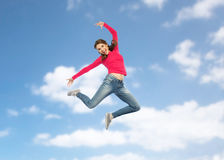 Happy young woman jumping in air or dancing Royalty Free Stock Images