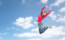 Happy young woman jumping in air or dancing Royalty Free Stock Photography