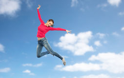 Happy young woman jumping in air or dancing Stock Photos