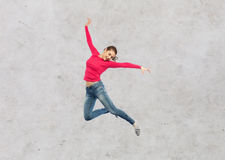 Happy young woman jumping in air or dancing Stock Photo