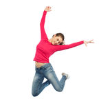 Happy young woman jumping in air or dancing Royalty Free Stock Photos
